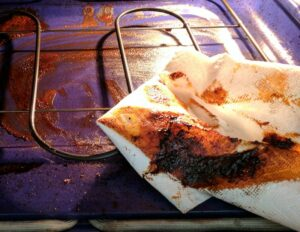 wipe oven with paper towel